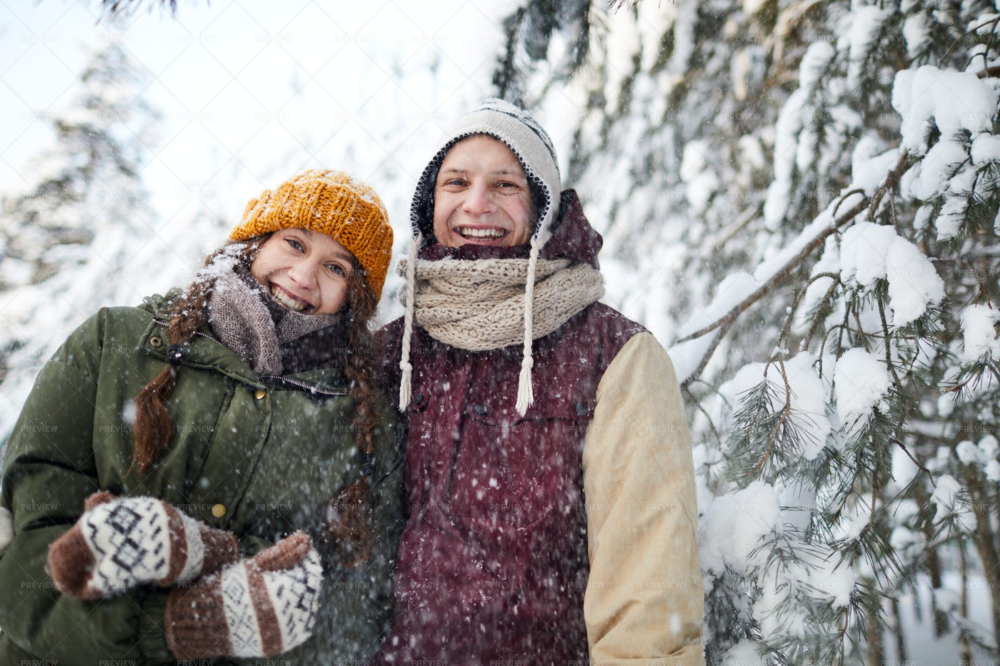 Couple In Snowfall: Stock Photos