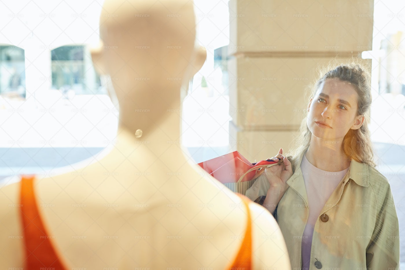Pensive Girl Viewing Clothing In...: Stock Photos