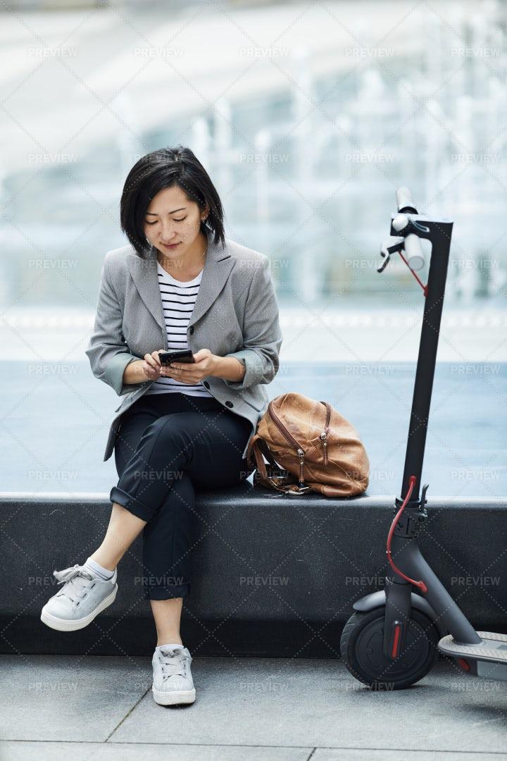 Modern Asian Woman Resting In Urban...: Stock Photos