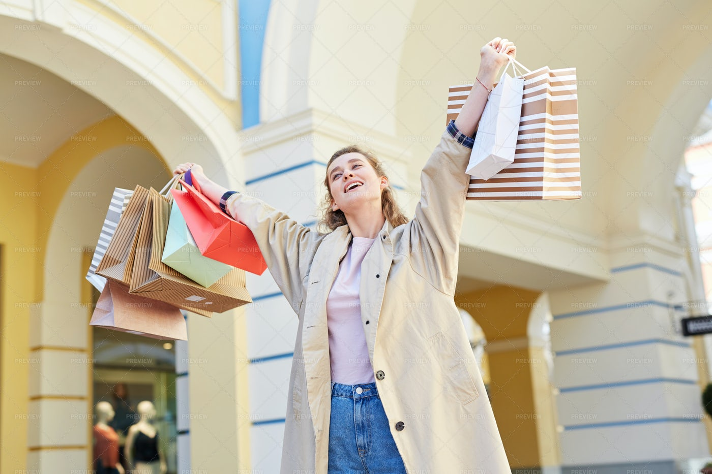 Excited Shopaholic With Paper Bags: Stock Photos