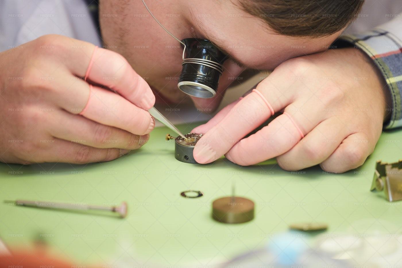 Clockmaker Fixing Watch: Stock Photos