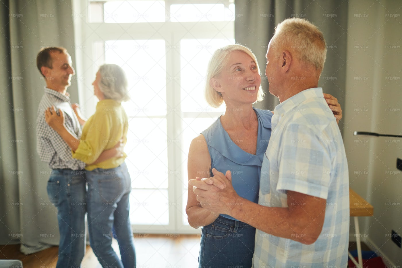 Senior People Slow Dancing At Party: Stock Photos