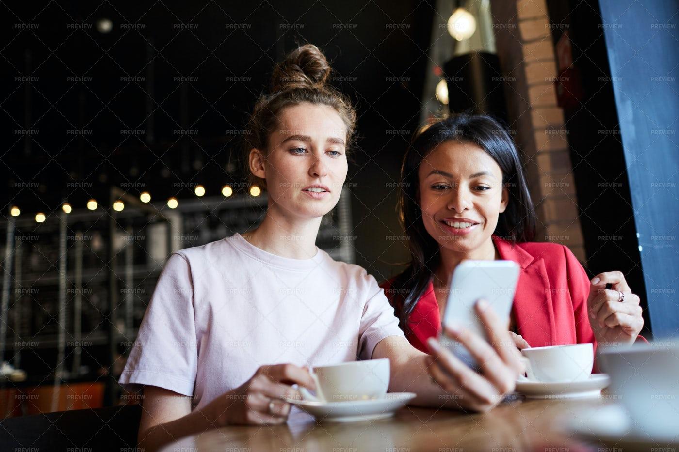 Positive Friends Using Mobile App...: Stock Photos