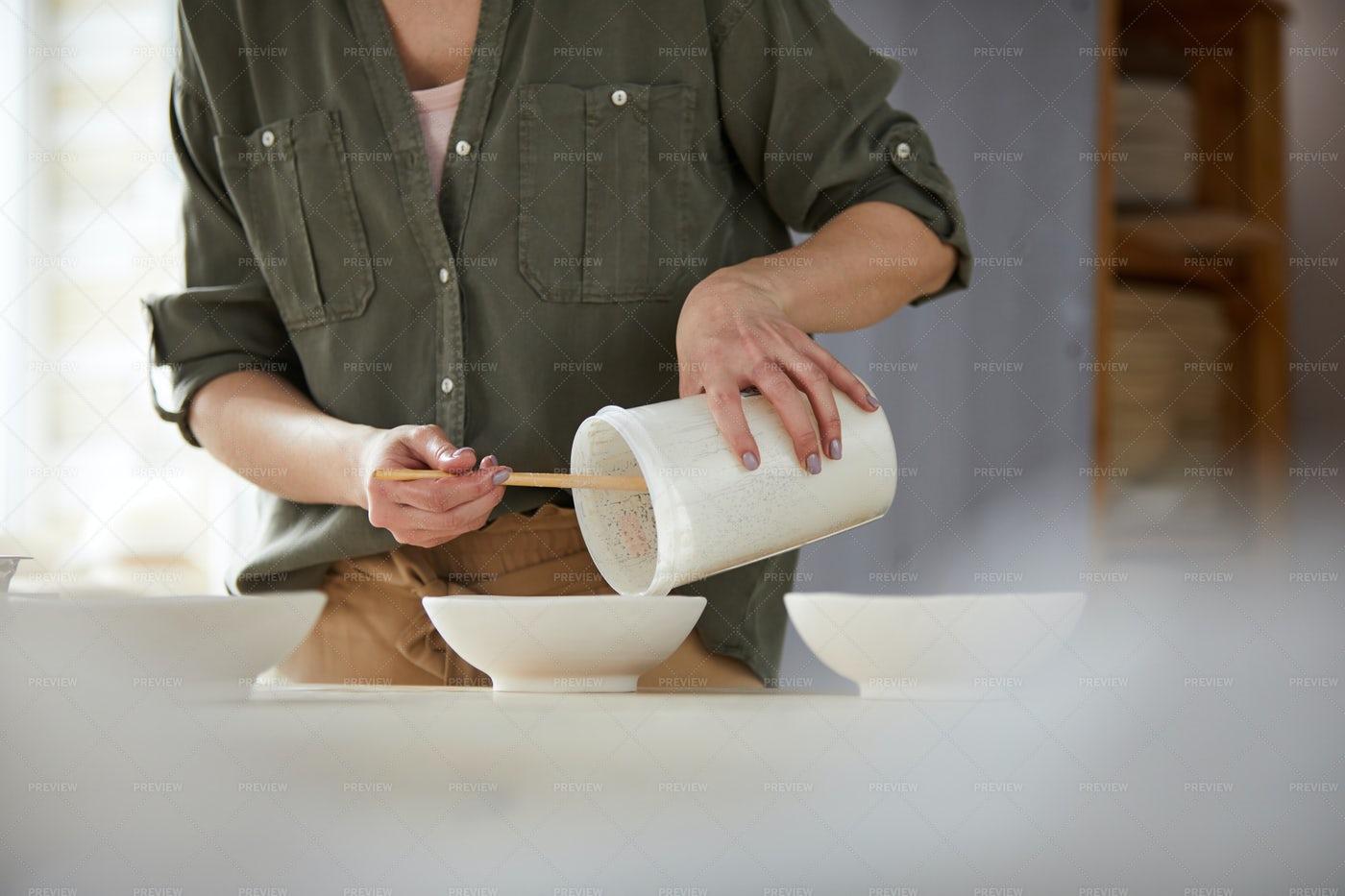 Potter Mixing Glaze: Stock Photos