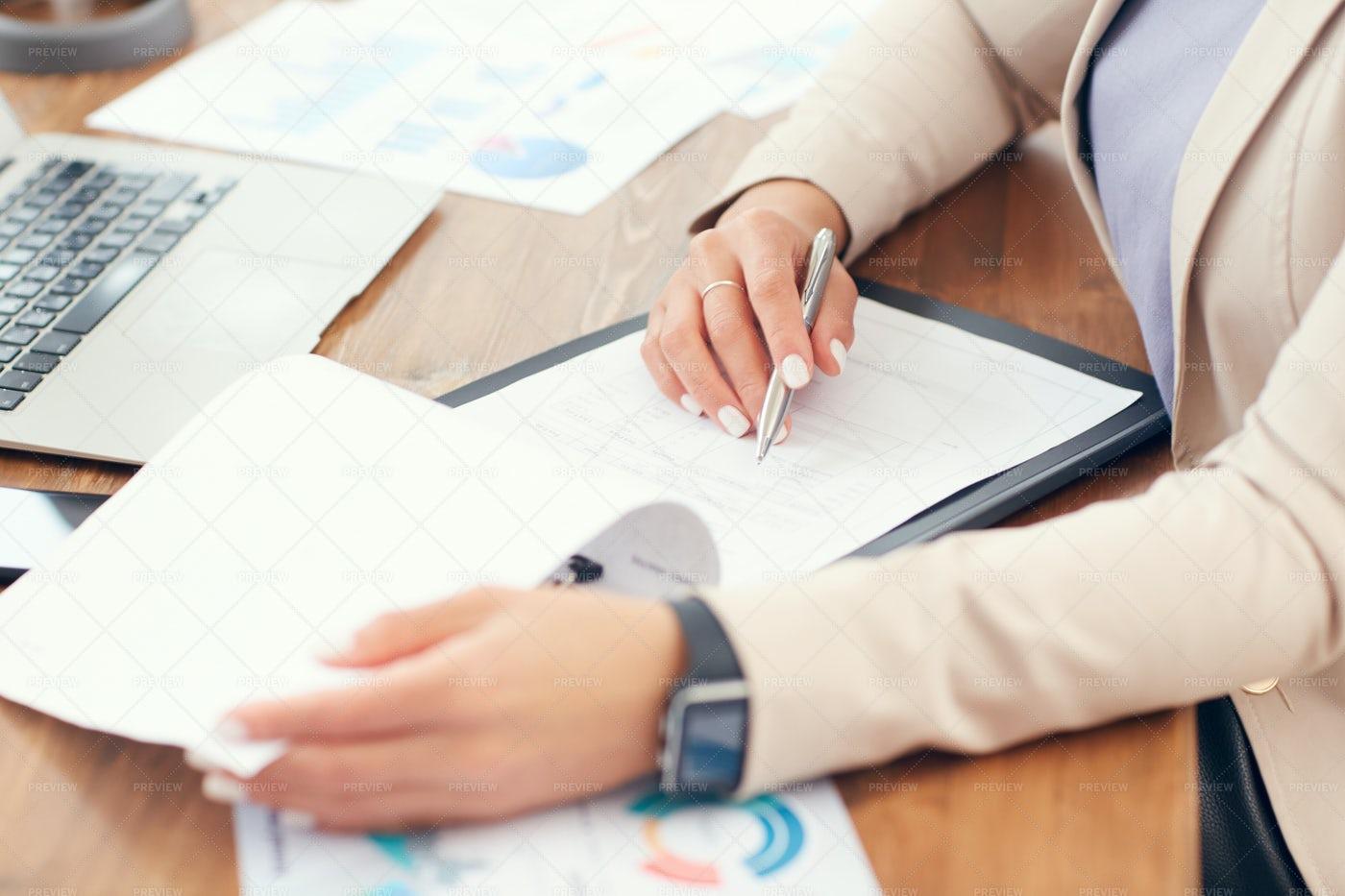 Businesswoman Doing Paperwork...: Stock Photos