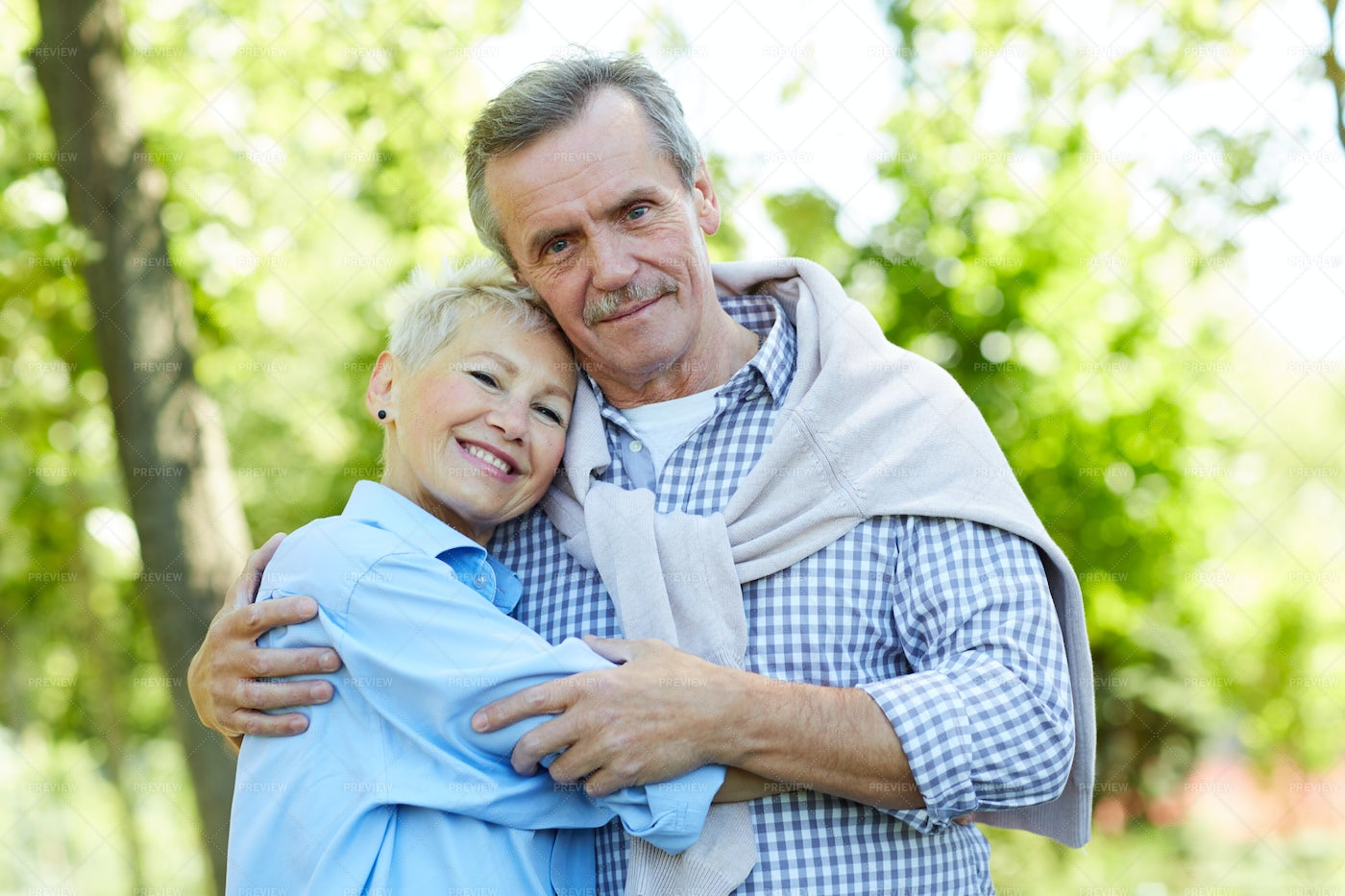 Happy Senior Couple Embracing In...: Stock Photos