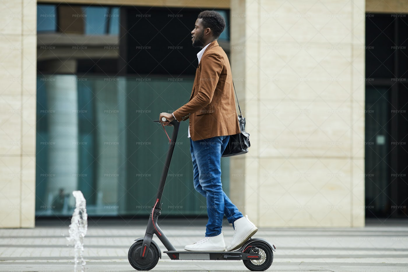 African Man Riding Electric Scooter...: Stock Photos