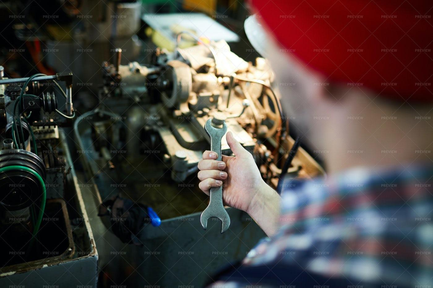 Unrecognizable Mechanic Holding...: Stock Photos