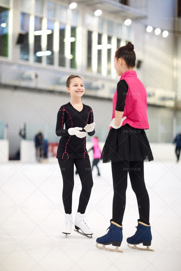 Girls Chatting On Ice Rink: Stock Photos