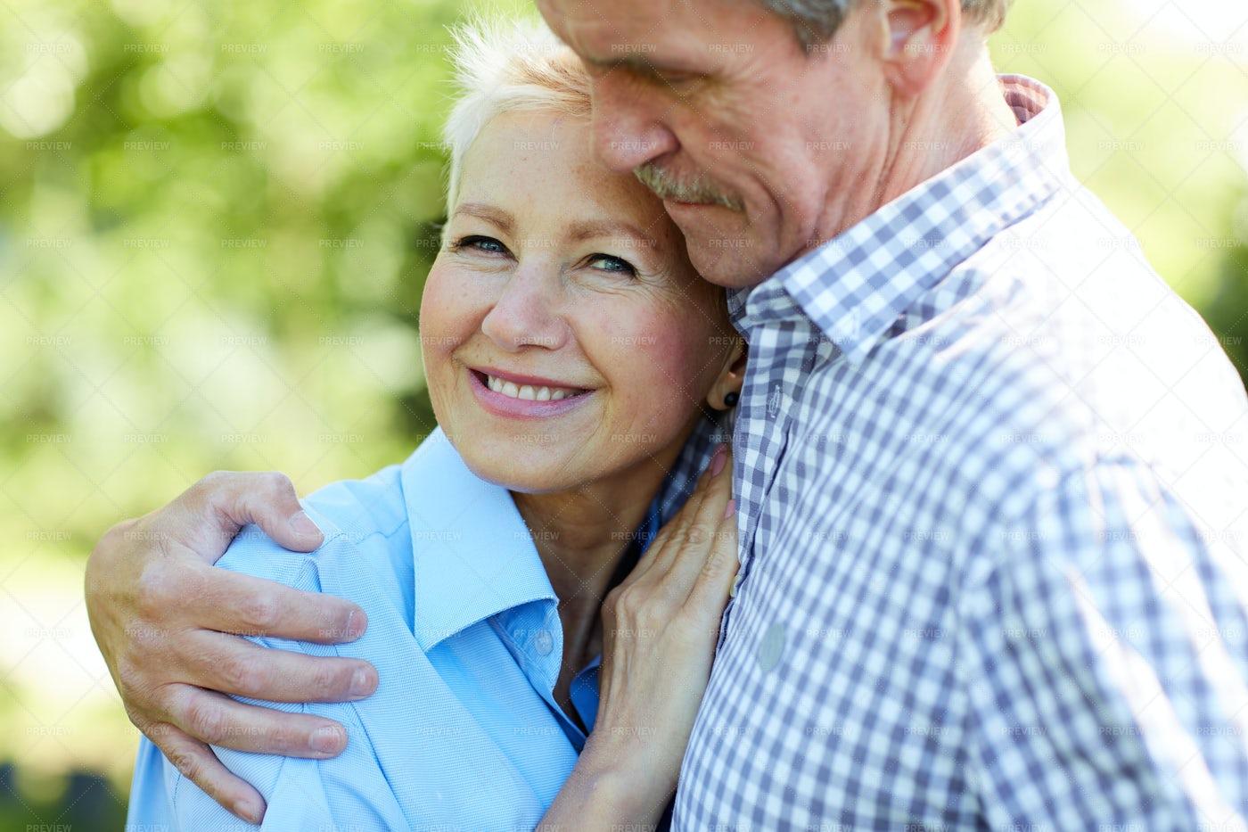 Caring Senior Couple Embracing In...: Stock Photos