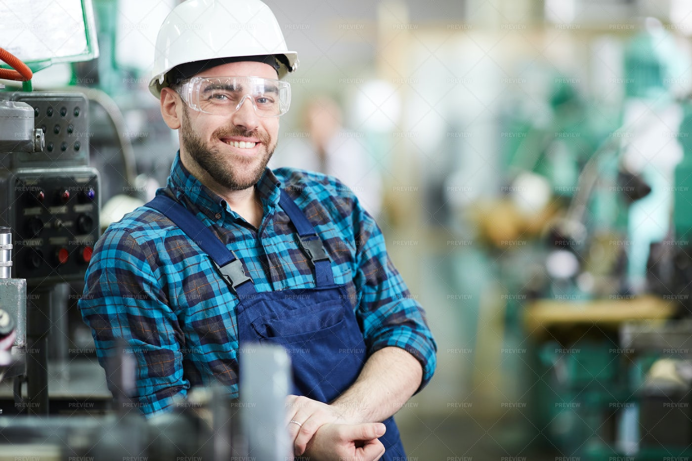 Smiling Factory Worker Posing: Stock Photos