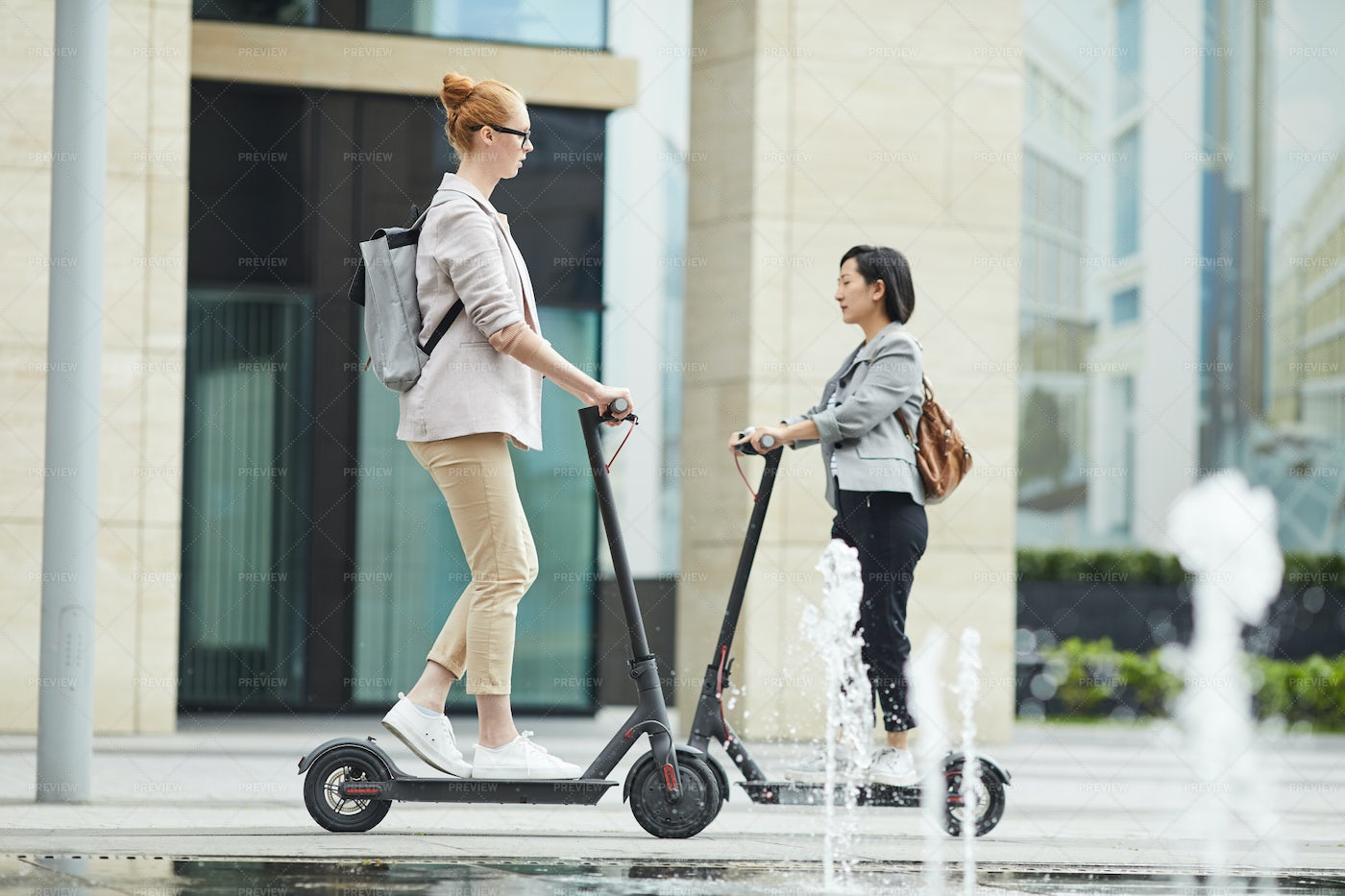 People Riding Electric Scooters In...: Stock Photos
