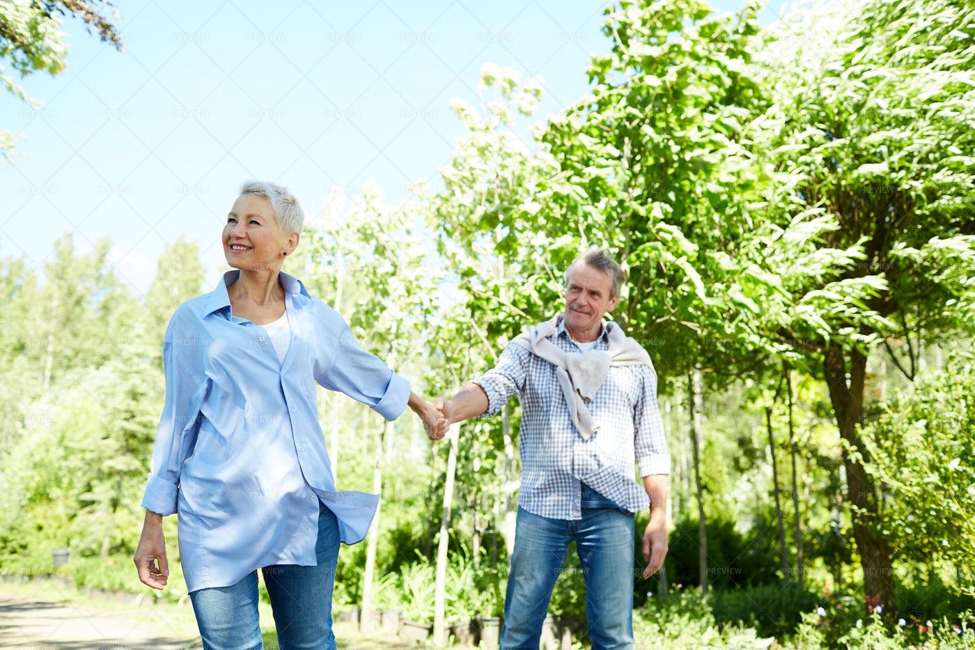 Senior Woman Leading Husband In...: Stock Photos