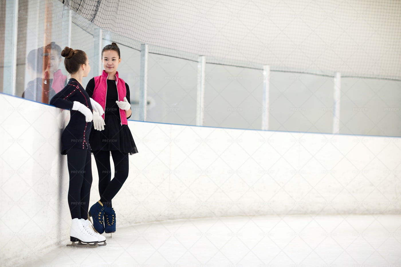 Two Figure Skaters Chatting: Stock Photos