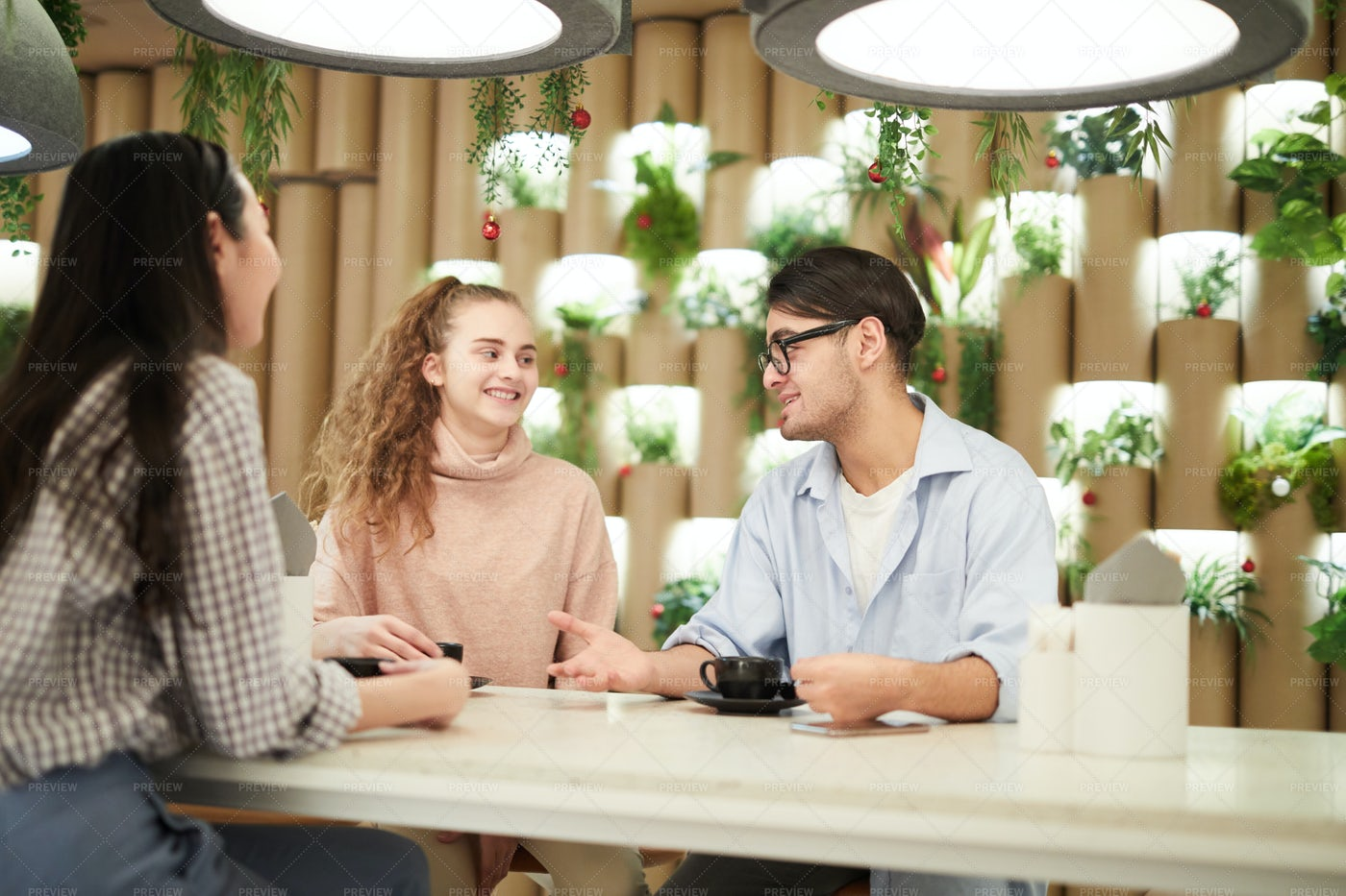 Group Of Students In Cafe: Stock Photos