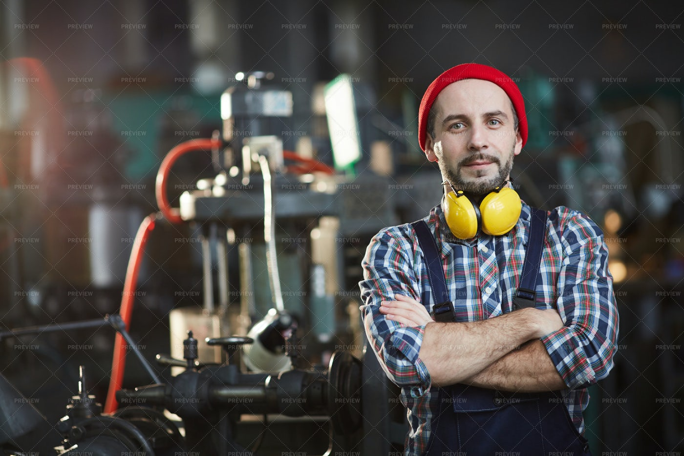 Worker Posing At Plant: Stock Photos