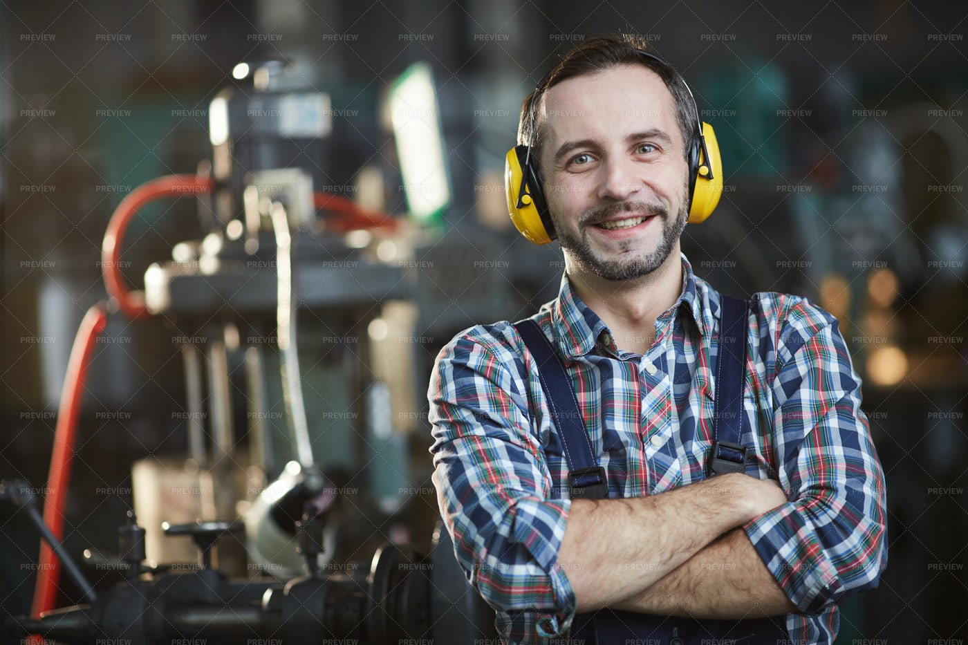 Smiling Worker Wearing Earmuffs: Stock Photos