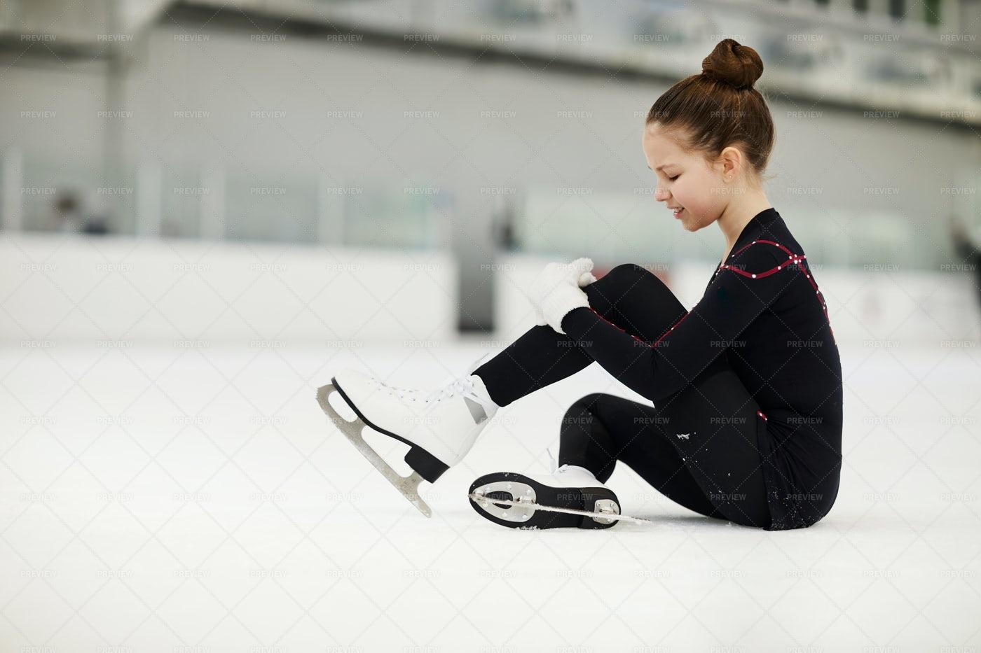 Injured Girl On Ice Rink: Stock Photos