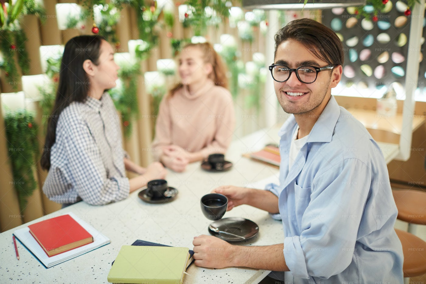 Smiling Mixed-race Student In Cafe: Stock Photos