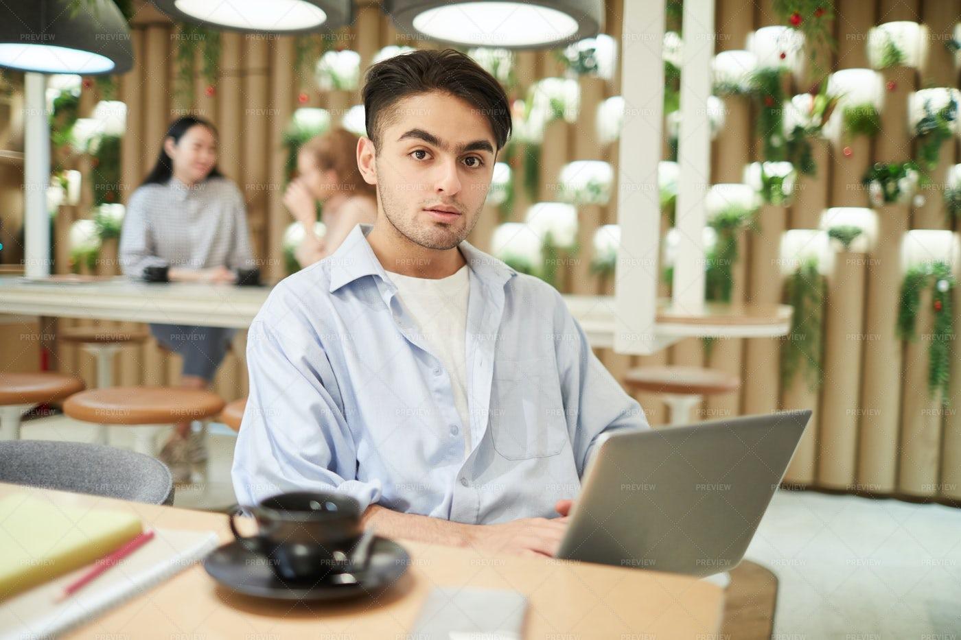 Mixed-Race Young Man Using Laptop...: Stock Photos