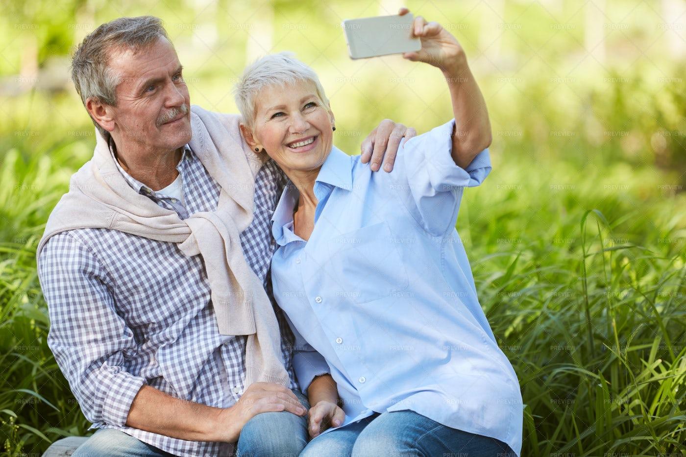 Senior Couple Taking Selfie: Stock Photos