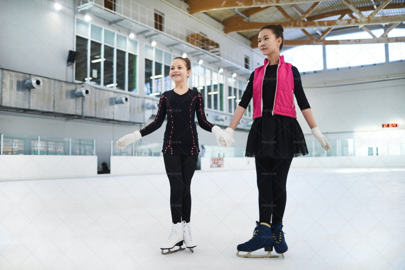 Two Figure Skaters Posing On Ice: Stock Photos