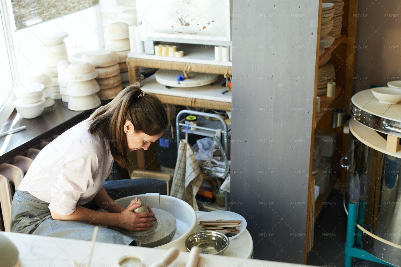 Modern Female Potter: Stock Photos