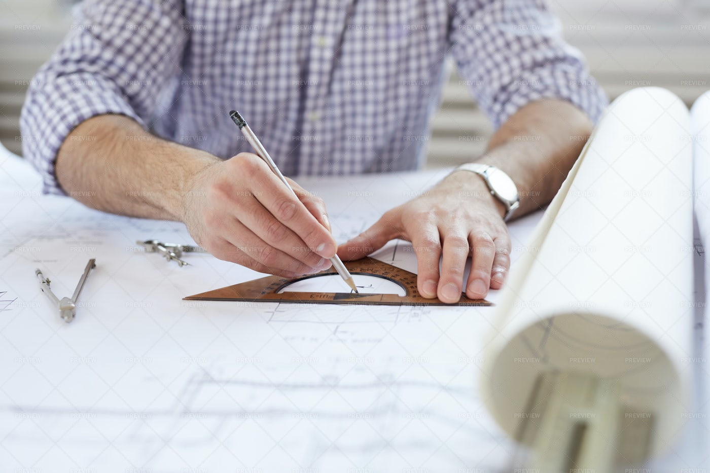 Engineer Drawing Plans At Workplace: Stock Photos