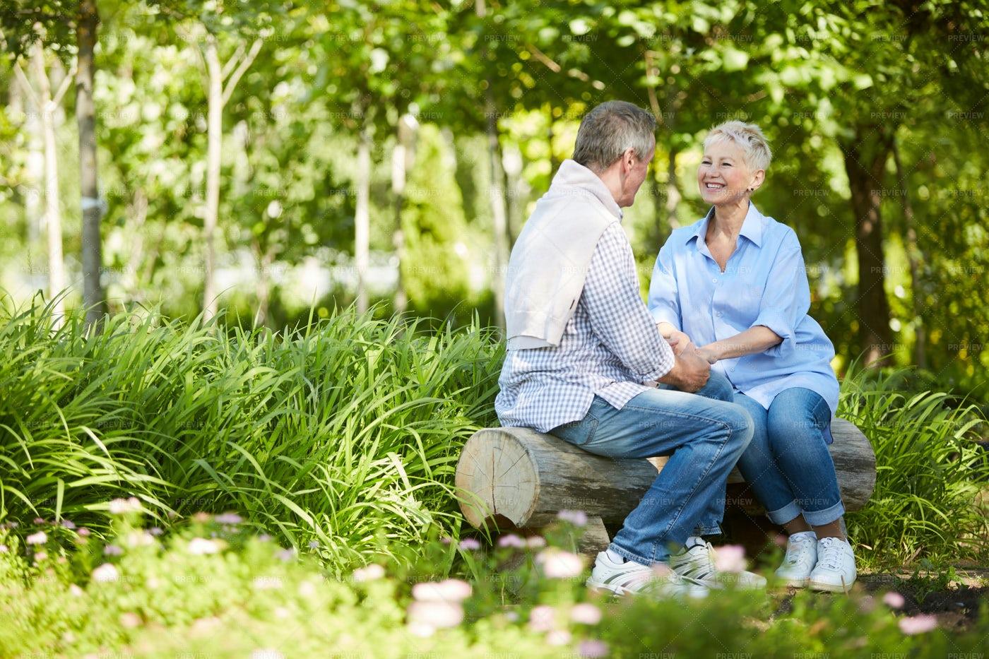 Senior Couple Enjoying Date In Park: Stock Photos