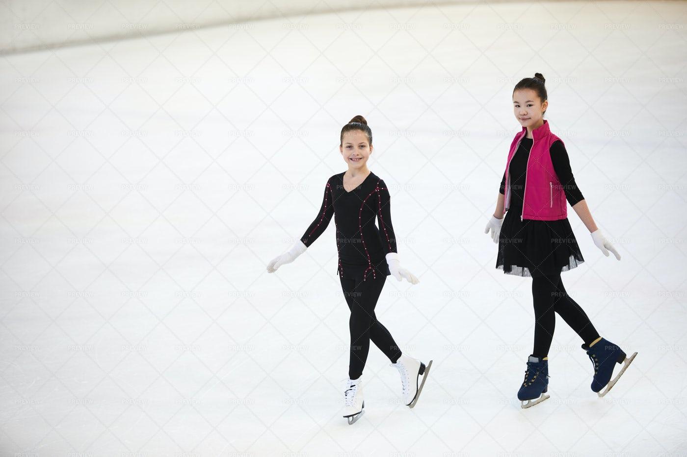 Girls Posing On Skating Rink: Stock Photos