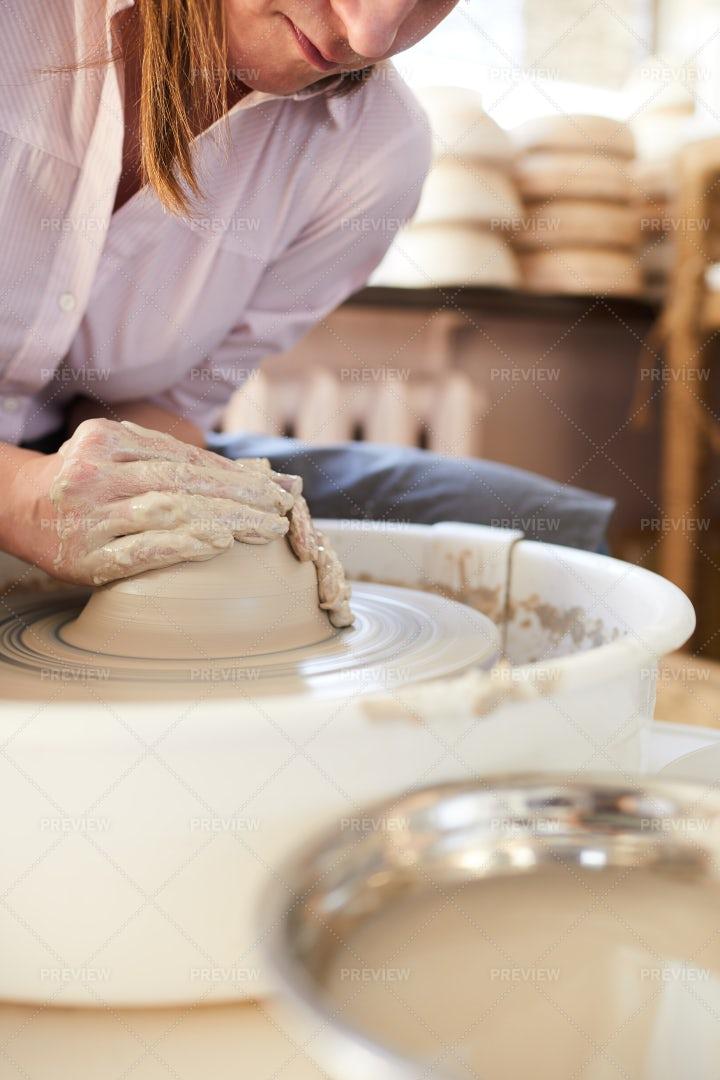 Modern Female Potter In Studio: Stock Photos