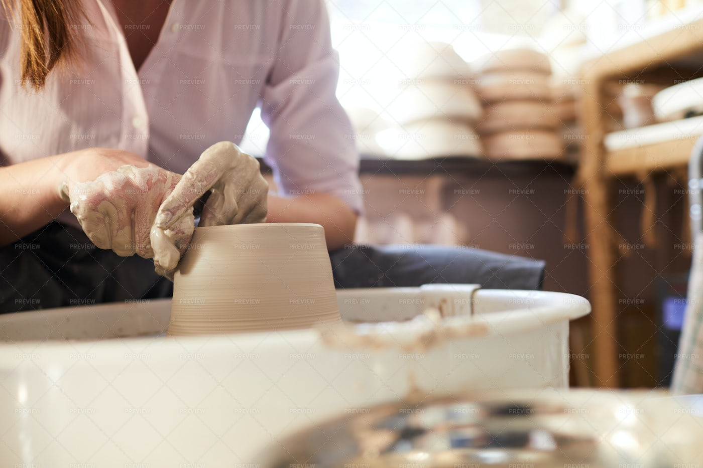 Woman Using Potters Wheel Closeup: Stock Photos