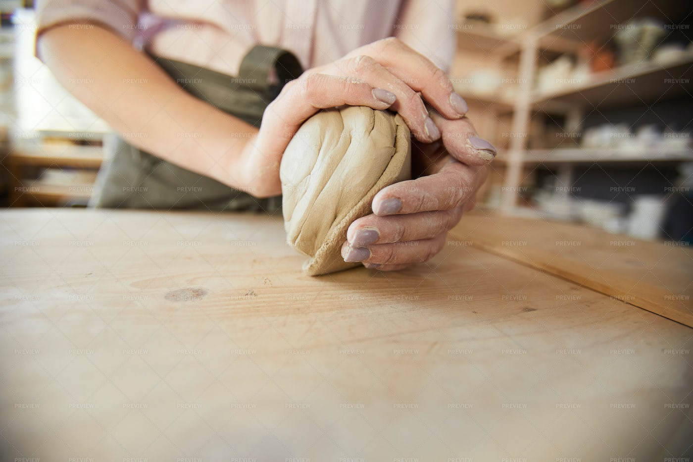 Female Potter Shaping Clay: Stock Photos