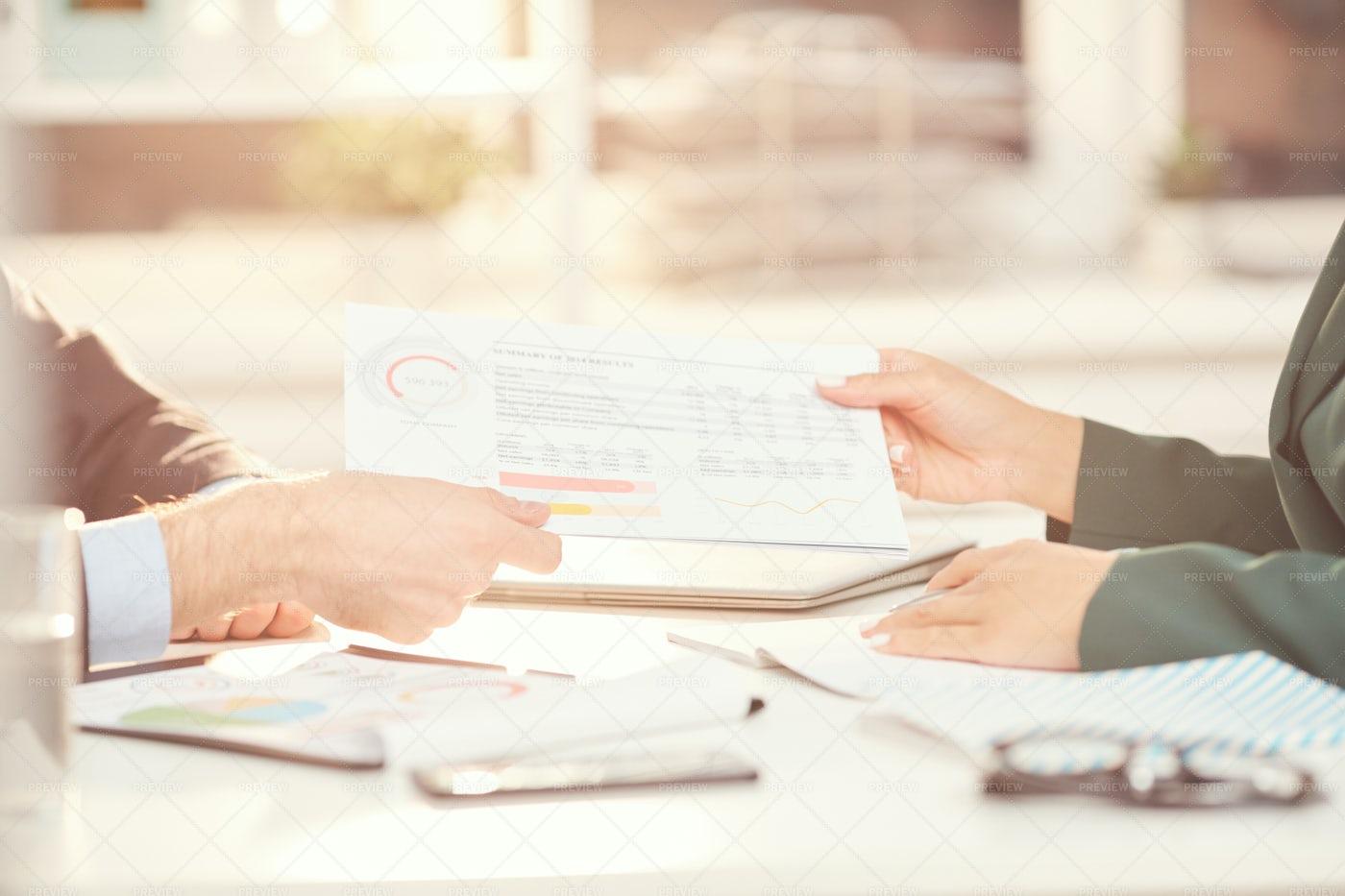Business People Handing Documents...: Stock Photos