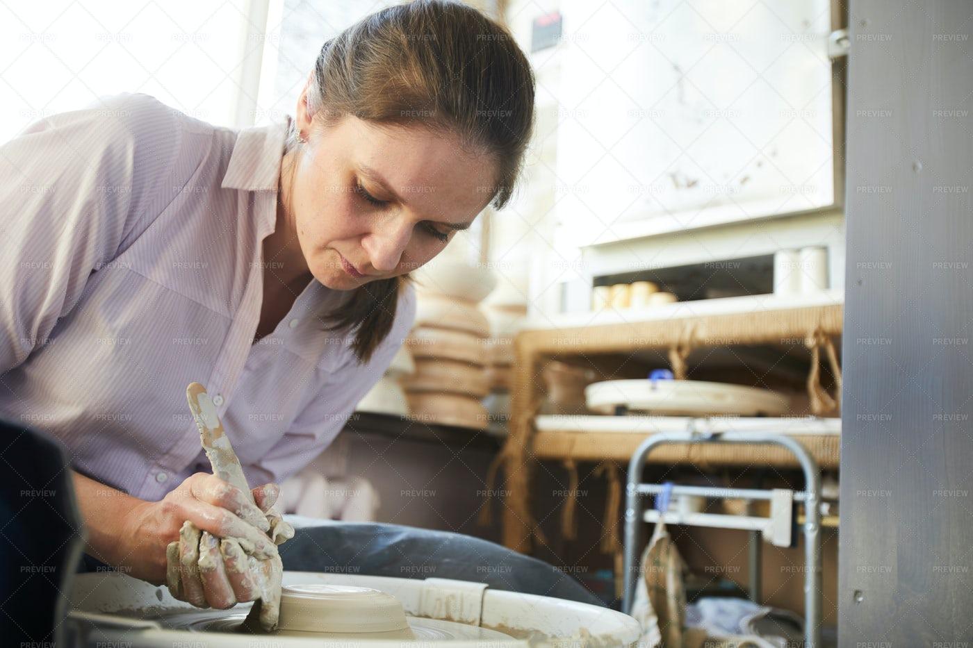 Female Potter Using Wheel: Stock Photos
