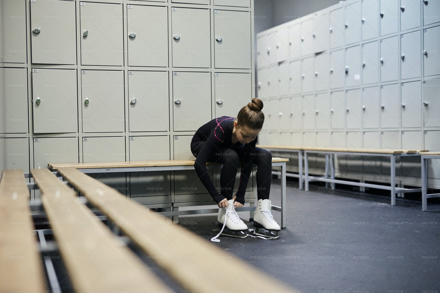 Girl Tying Skates In Dressing Room: Stock Photos