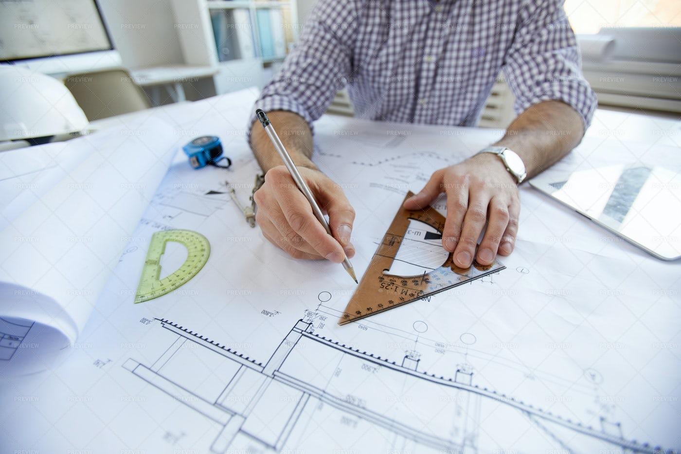 Engineer Drawing Plans  Closeup: Stock Photos