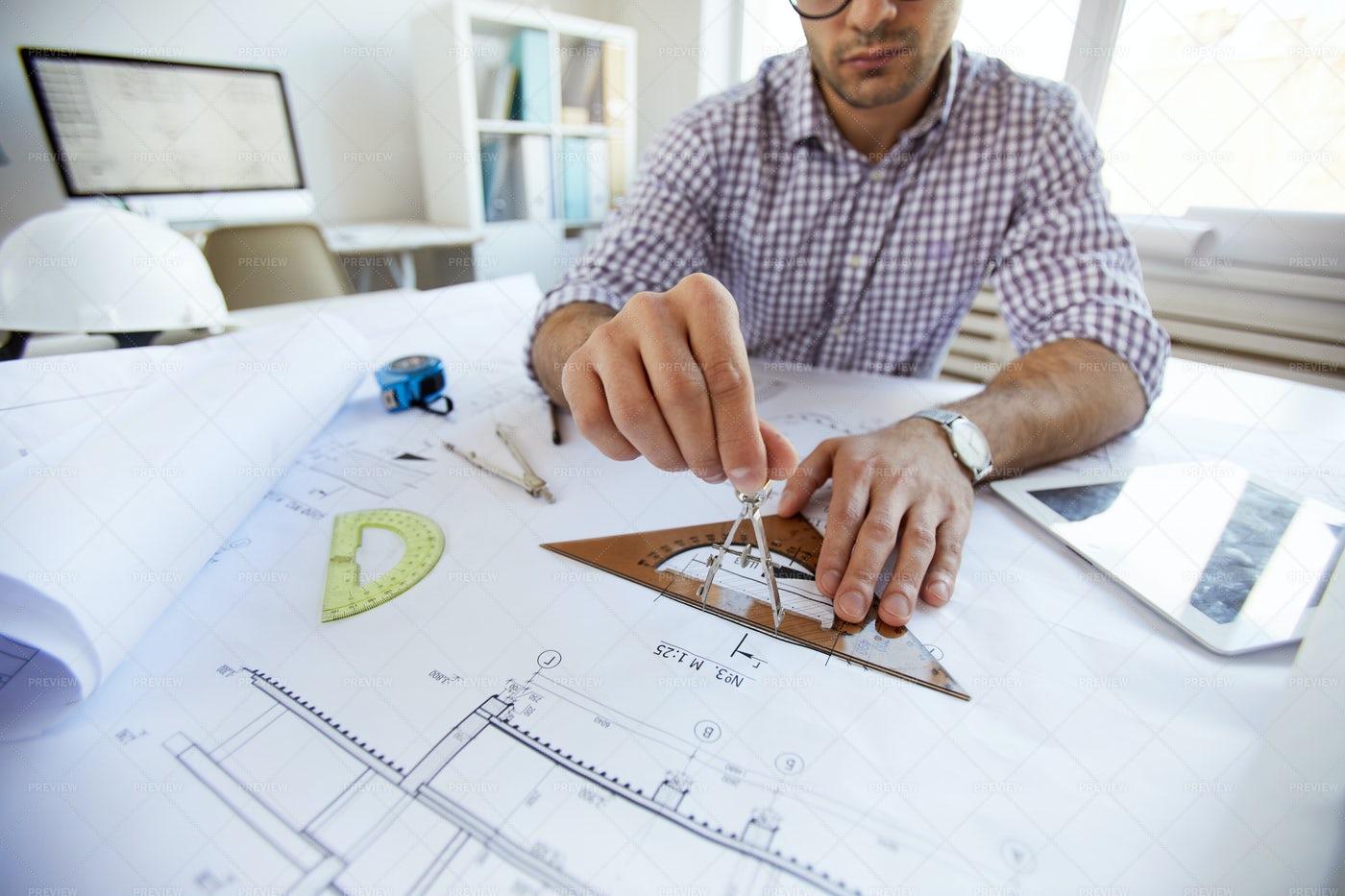 Engineer Drawing Plans  Close Up: Stock Photos