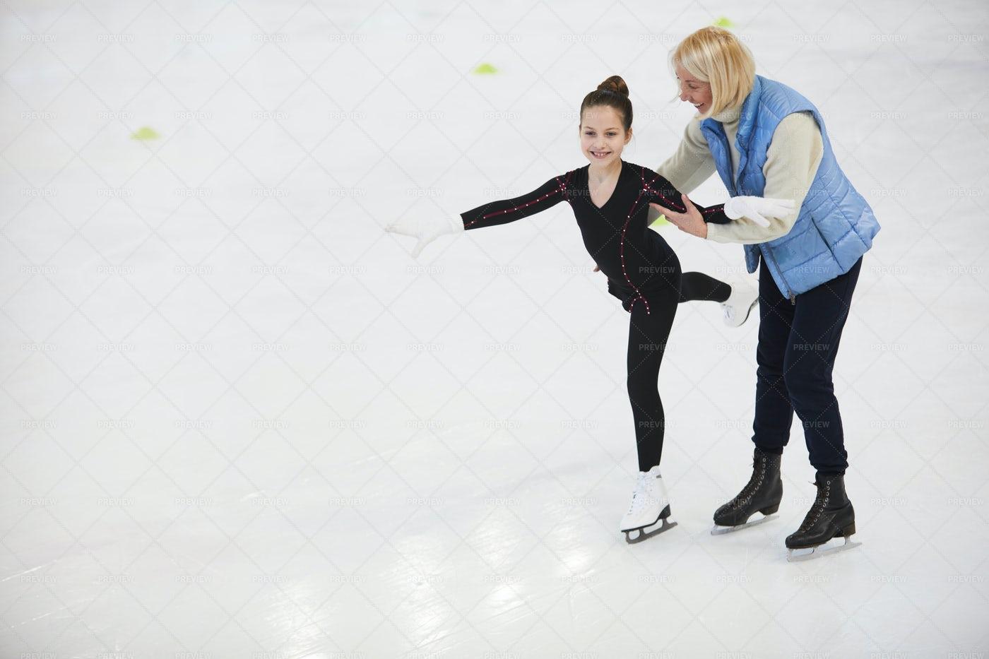 Coach Helping Girl Figure Skating: Stock Photos