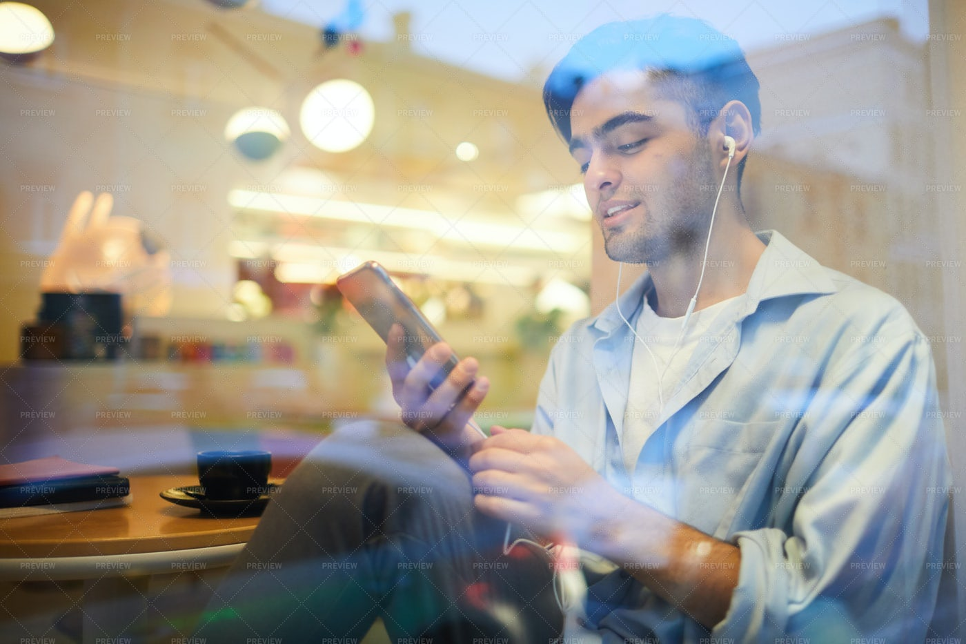 Middle-Eastern Man Listening To...: Stock Photos