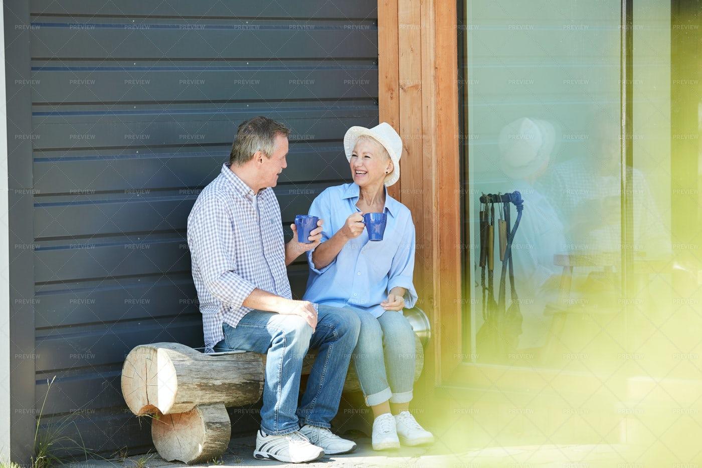 Senior Couple Drinking Tea In Front...: Stock Photos