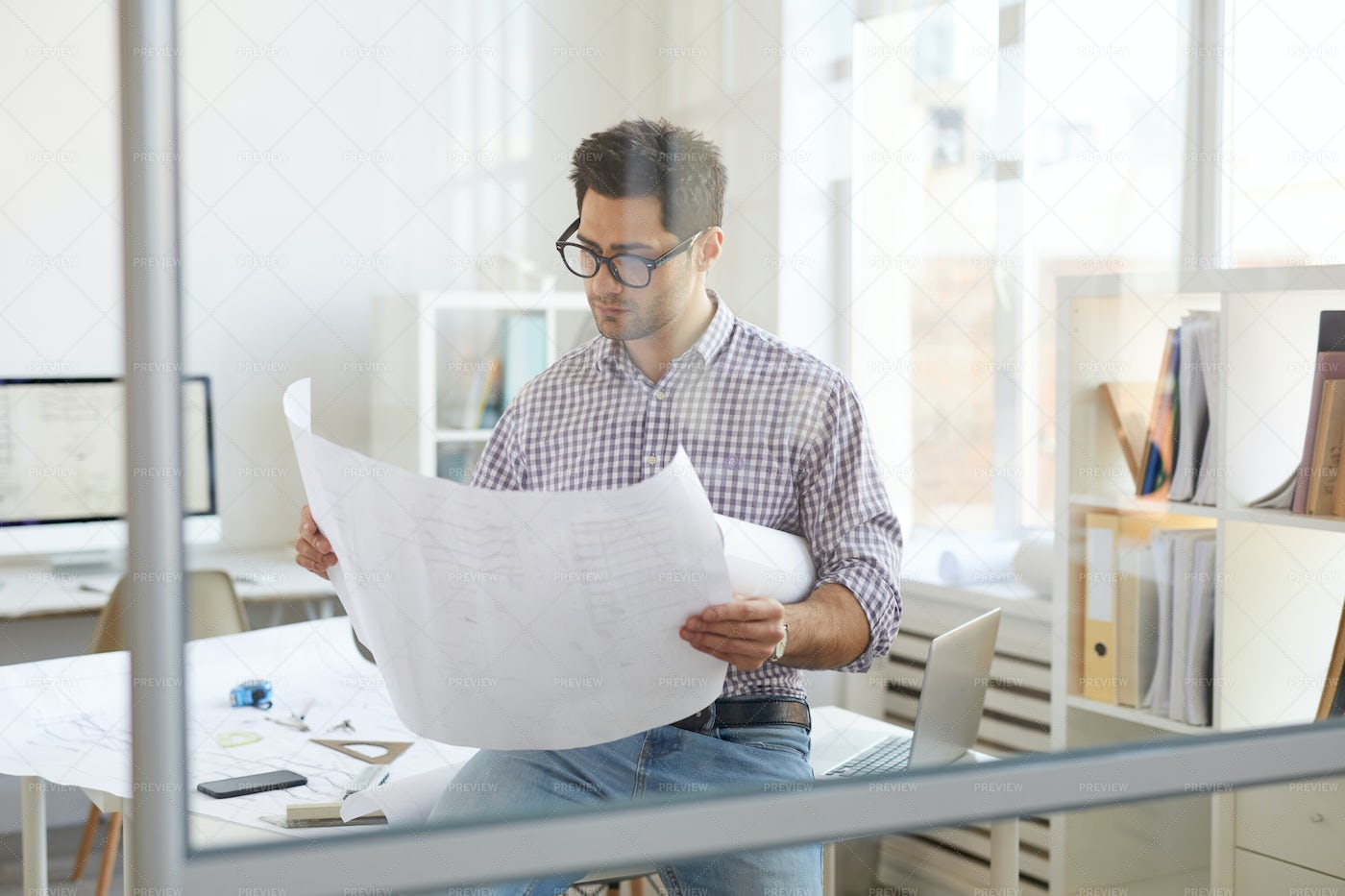 Engineer At Workplace Behind Glass: Stock Photos