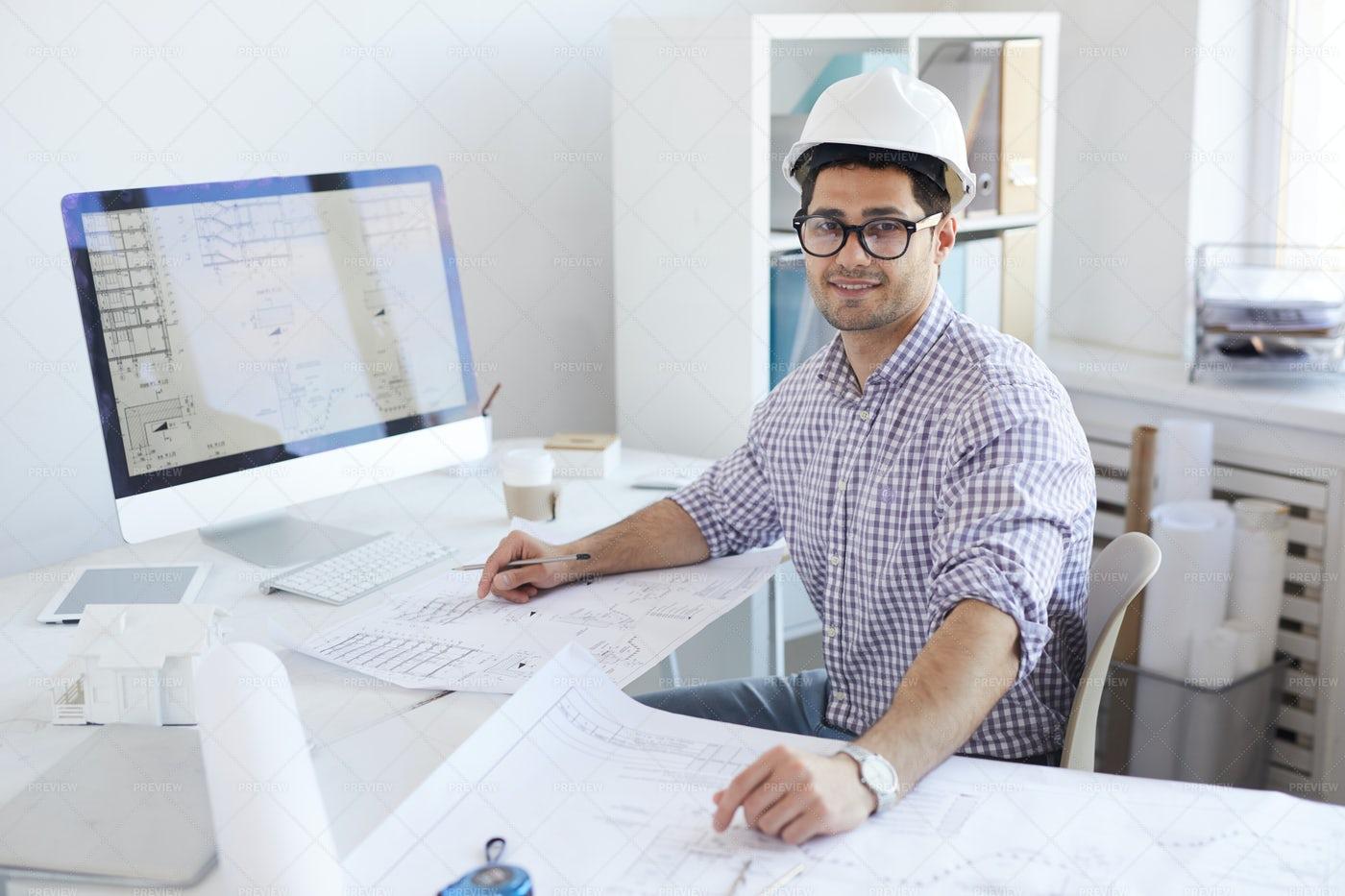 Smiling Engineer Posing At...: Stock Photos