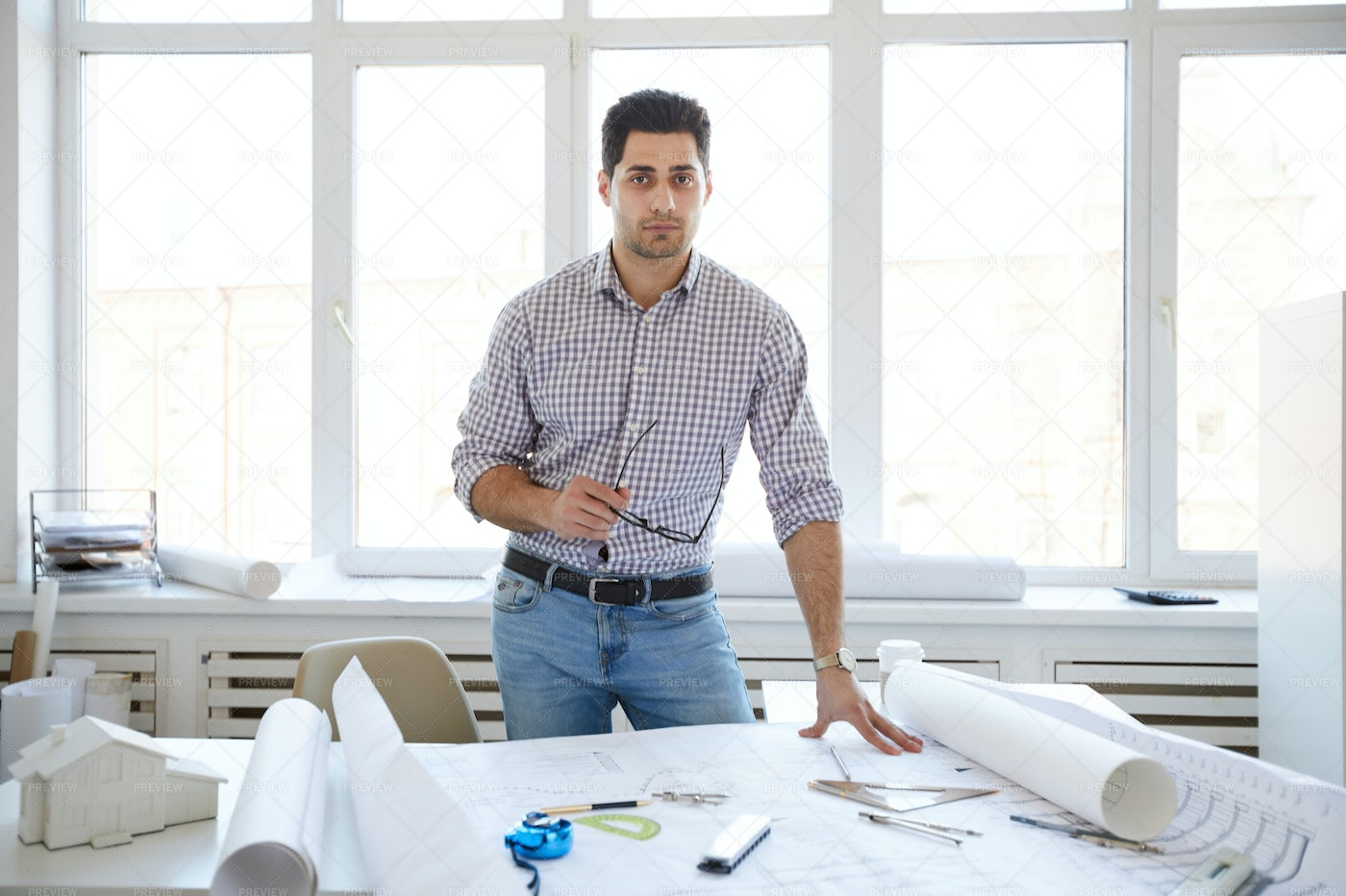 Handsome Engineer Posing In Office: Stock Photos