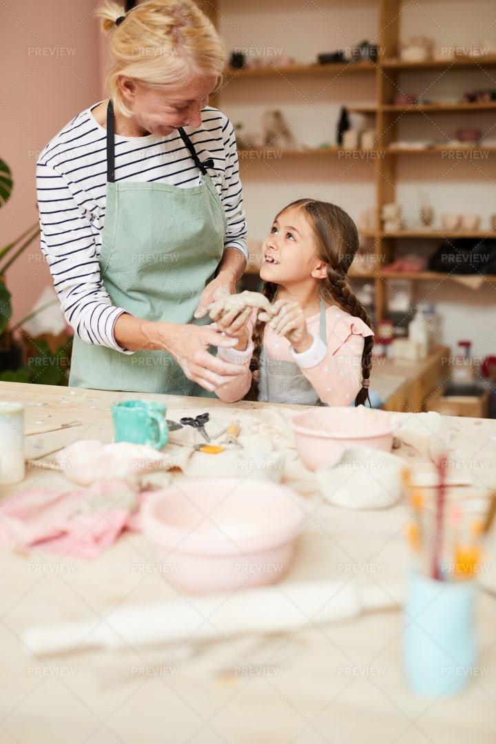 Little Girl Enjoying Pottery: Stock Photos