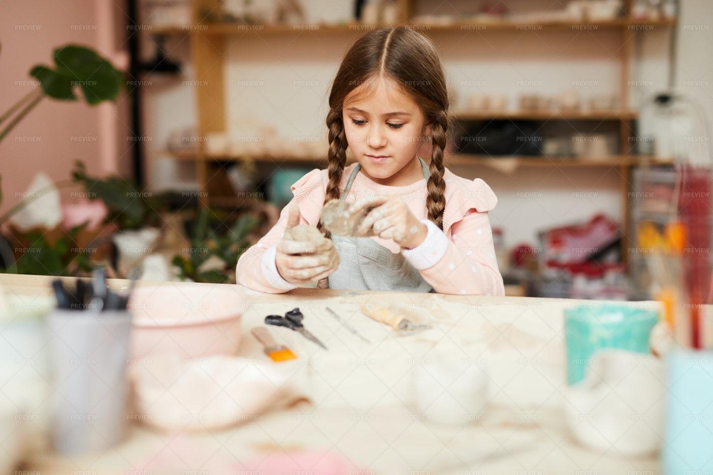 Cute Little Girl Shaping Clay: Stock Photos