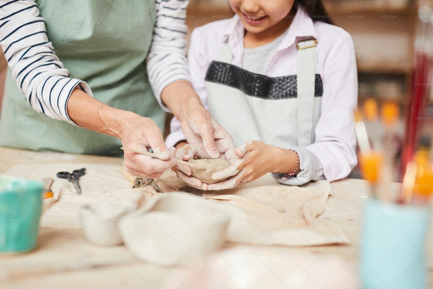 Little Girl Kneading Clay: Stock Photos
