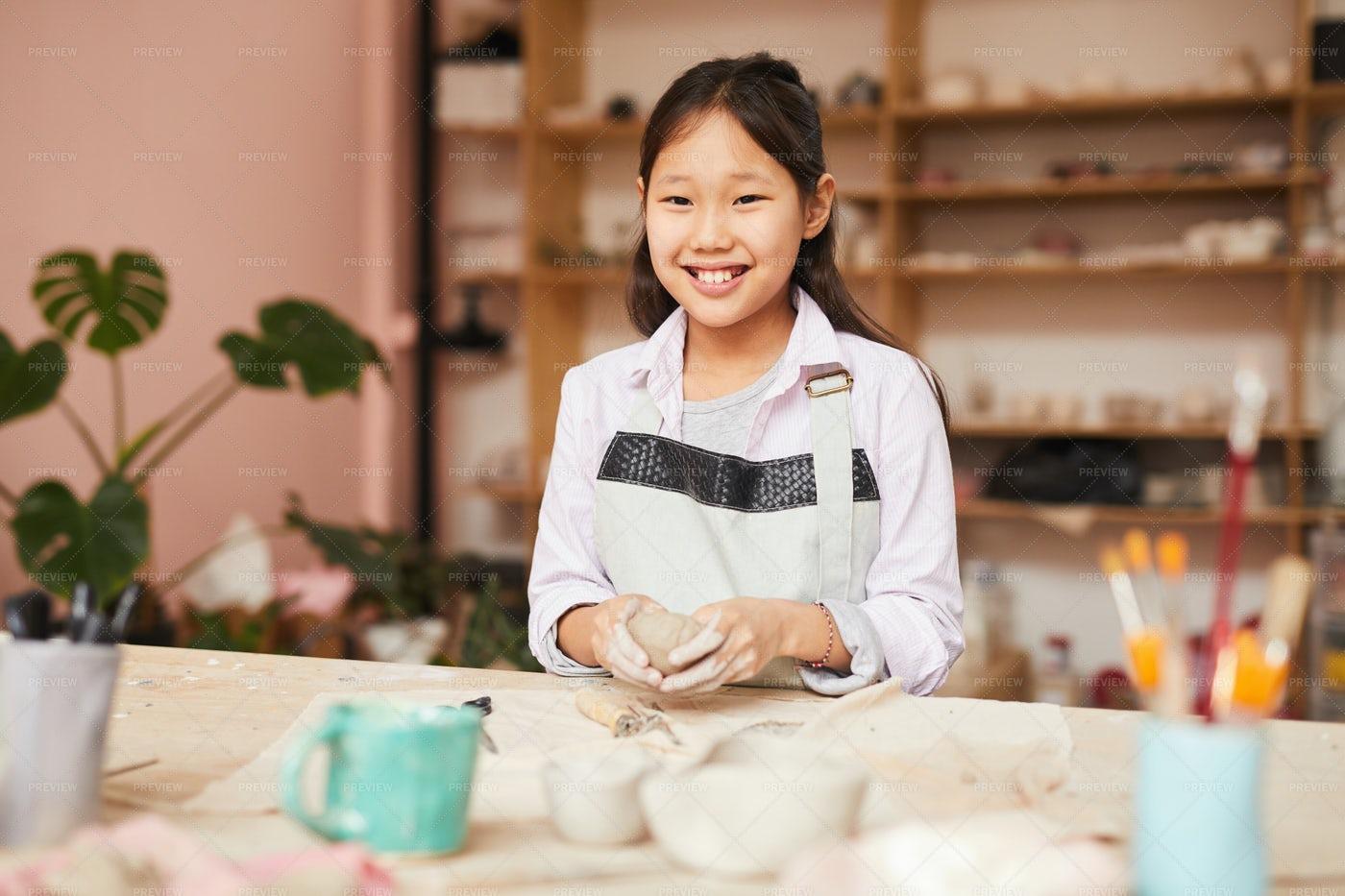 Smiling Asian Girl Enjoying Pottery...: Stock Photos