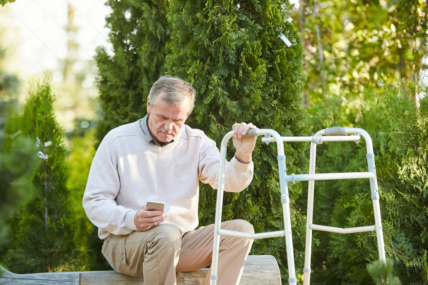 Senior Man With Walker Resting In...: Stock Photos