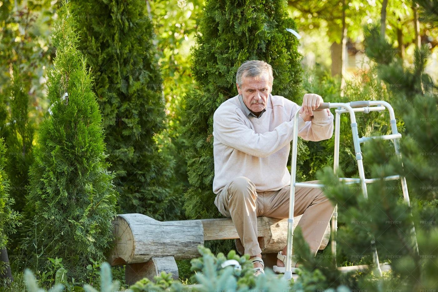 Depressed Senior Man With Walker: Stock Photos
